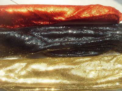 Three finish scale is arranged in roll like cloth, which colors are orange, black and golden.