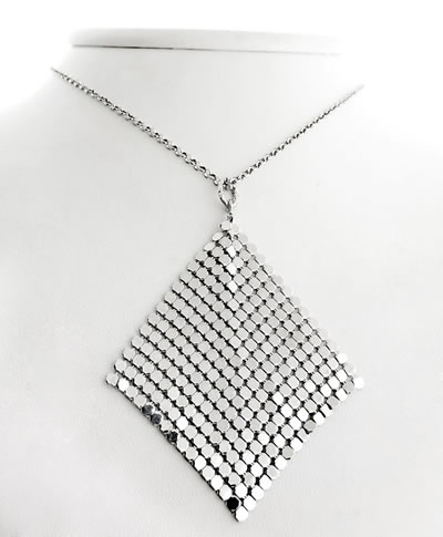 A necklace is hanging on a plastic model, and its pendant is scale mesh curtain.