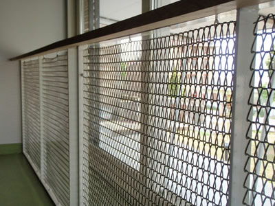 Wire mesh belt is as room divider, the outside of belt mesh is a yard.